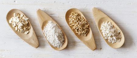 Wooden shovels with oat grains, flakes and bran LANG_EVOIMAGES