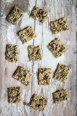 conformance: Seed crackers with hemp seeds on wood LANG_EVOIMAGES