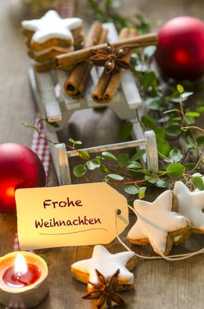 Christmas decoration with miniature sledge, tea light and cinnamon stars LANG_EVOIMAGES