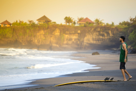 Indonesia, Bali, surfer on the beach