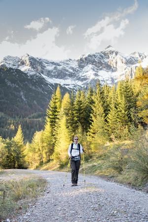 secluded: Austria, Salzburg State, Maria Alm, woman hiking in alpine landscape