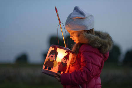 Little girl with self-made paper lantern in the evening LANG_EVOIMAGES
