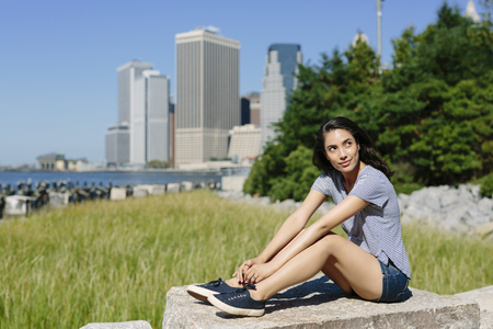USA, New York City, portrait of young woman relaxing in the sun LANG_EVOIMAGES