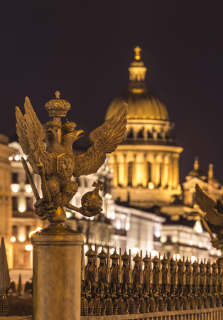 lighted: Russia, Saint Petersburg, Double eagle inf ront of Palace Square and St. Isaacs Cathedral