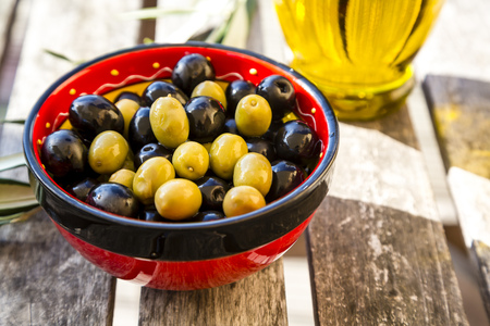 Bowl with green and black olives