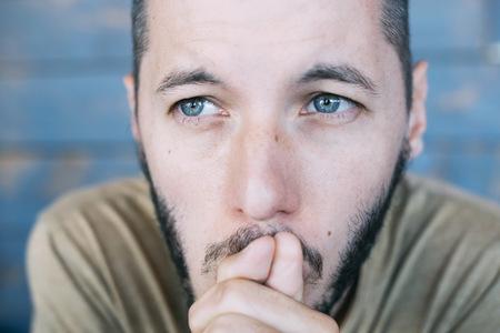 Bearded man thinking