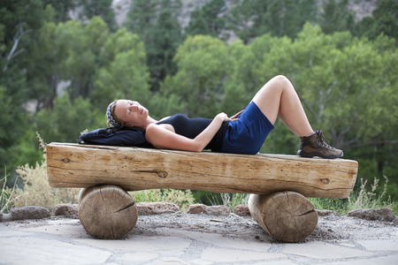 USA, New Mexico, woman relaxing on bench