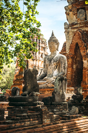 Thailand, Ayutthaya, view to ancient Buddha statue LANG_EVOIMAGES