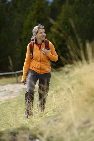 Italy, Alto Adige, Urtijei, portrait of smiling hiker