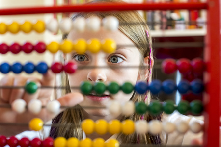 figuring: Girl using abacus