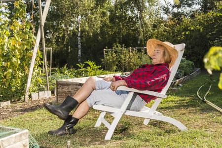 Senior woman relaxing from gardening