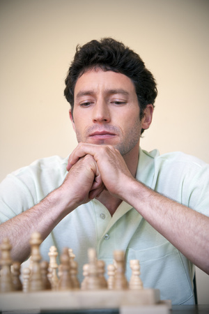 Portrait of man playing chess