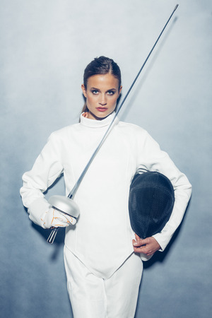 provoking: Portrait of young female fencer with weapon LANG_EVOIMAGES