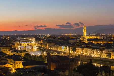 Italy, Tuscany, Florence, Cityscape, View of Arno river, Ponte Vecchio and Palazzo Vecchio in the evening LANG_EVOIMAGES