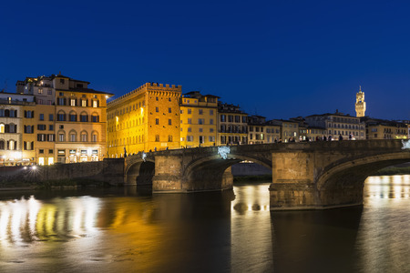 lighted: Italy, Tuscany, Florence, View of Arno River and Ponte Vecchio in the evening LANG_EVOIMAGES