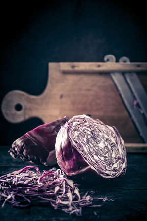 Red cabbage and old wooden grater LANG_EVOIMAGES