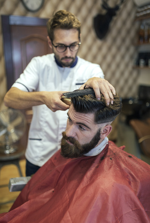 analytic: Barber cutting hair of a customer
