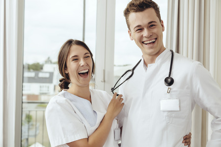 open windows: Nurse and young doctor flirting at work
