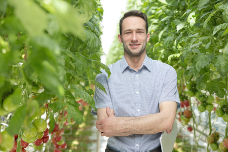 Portrait of smiling man in greenhouse