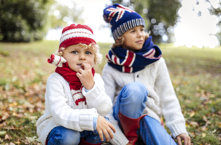 Portrait of blond little boy and his brother in the background  wearing fashionable knit wear in autumn LANG_EVOIMAGES