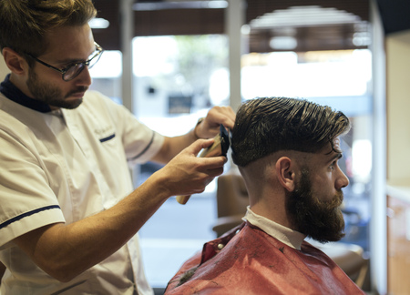 analytic: Barber shaving head of a customer