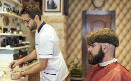 Barber and customer in a barber shop