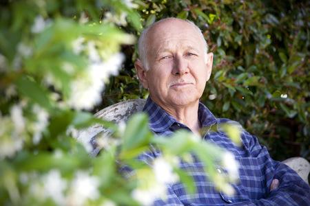 Portrait of senior man sitting in the garden