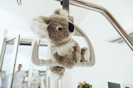 gallow: Toy koala hanging on bed gallow in hospital room