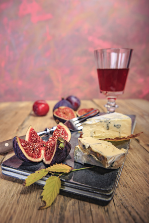 Still life with wine, figs and cheese