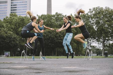 motivations: Four women having an outdoor workout LANG_EVOIMAGES