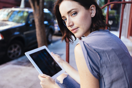 USA, New York City, portrait of woman with digital tablet