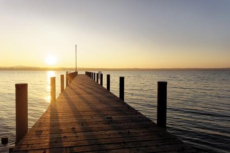 Germany, Bavaria, Starnberg lake, boat bridge at sunset