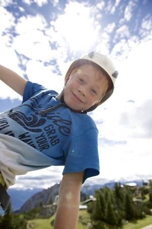 Austria, Tyrol, Rofan mountains, young boy climbing LANG_EVOIMAGES
