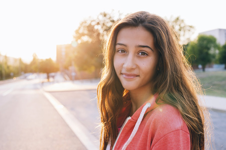 lighted: Portrait of happy girl at backlight