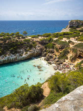 incidental people: Spain, Baleares, Mallorca, View of bay Calo des Moro