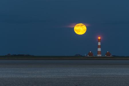 westerheversand: Germany, Schleswig-Holstein, North Sea Coast, View of Westerheversand Lighthouse, full moon at night