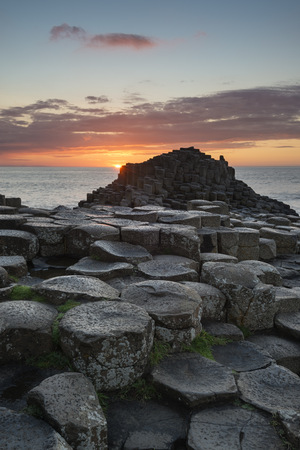 United Kingdom, Northern Ireland, County Antrim, View of causeway coast, Giants Causeway at sunset