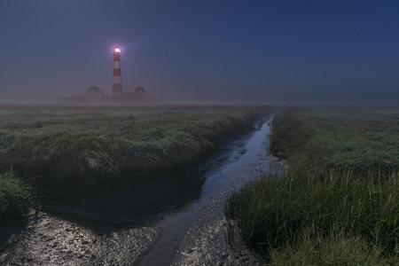 westerheversand: Germany, Schleswig-Holstein, North Frisia, View of Westerheversand Lighthouse at night, fog