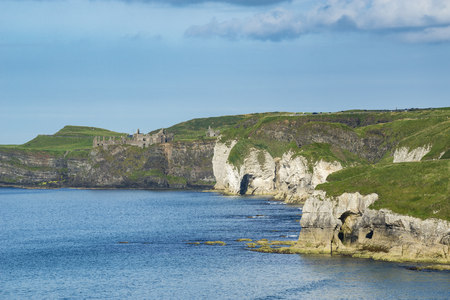 United Kingdom, Northern Ireland, County Antrim, View of Chalk coast and Dunluce Castle