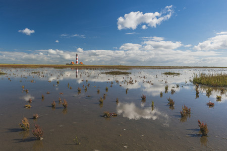 Germany, Schleswig-Holstein, North Sea Coast, View of Westerheversand Lighthouse, tideland