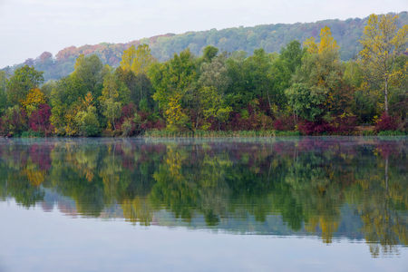 Germany, Pfuhler See, quarry pond in autumn, Panorama