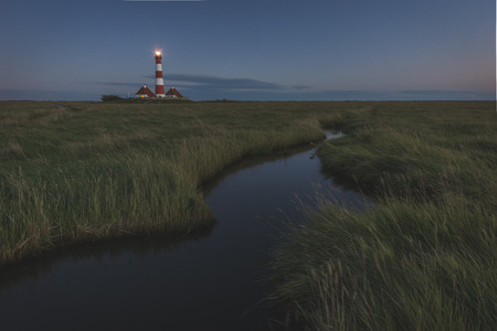 westerhever: Germany, Schleswig-Holstein, North Sea Coast, View of Westerheversand Lighthouse in the evening