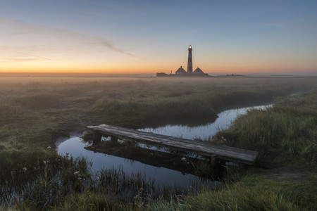 Germany, Schleswig-Holstein, North Frisia, View of Westerheversand Lighthouse in the morning light