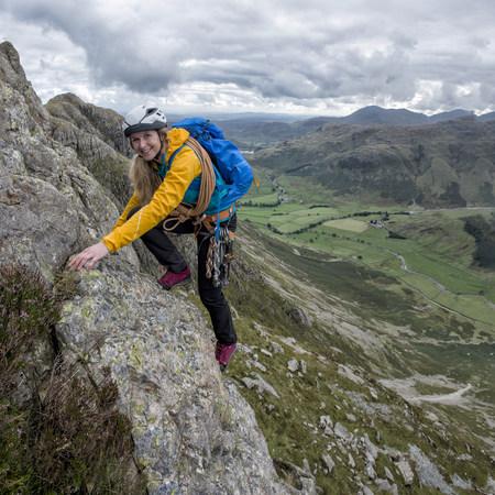 cumbria: UK, Lake District, Great Langdale, woman scrambling at Pike of Stickle
