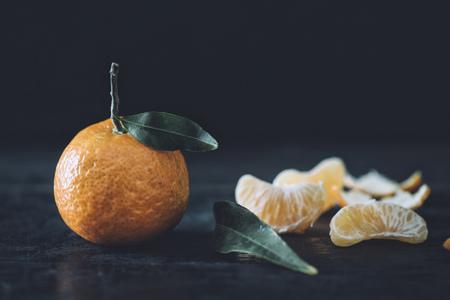 Tangerine in front of dark background