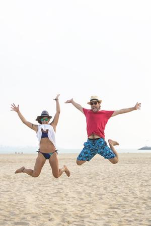 ardor: Spain, Cadiz, El Puerto de Santa Maria, Couple jumping on the beach