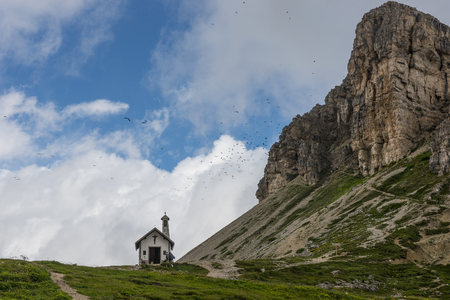 Italy, Alto Adige, Dolomites, view to chapel and peak of Tower of Toblin
