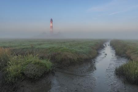 westerhever: Germany, Schleswig-Holstein, North Sea Coast, View of Westerheversand Lighthouse, fog