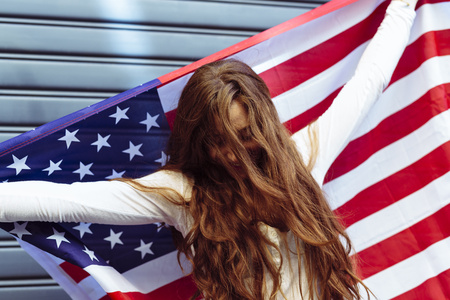 Woman holding an American flag with confidence