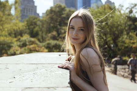 incidental people: USA, New York City, portrait of young woman in Central Park